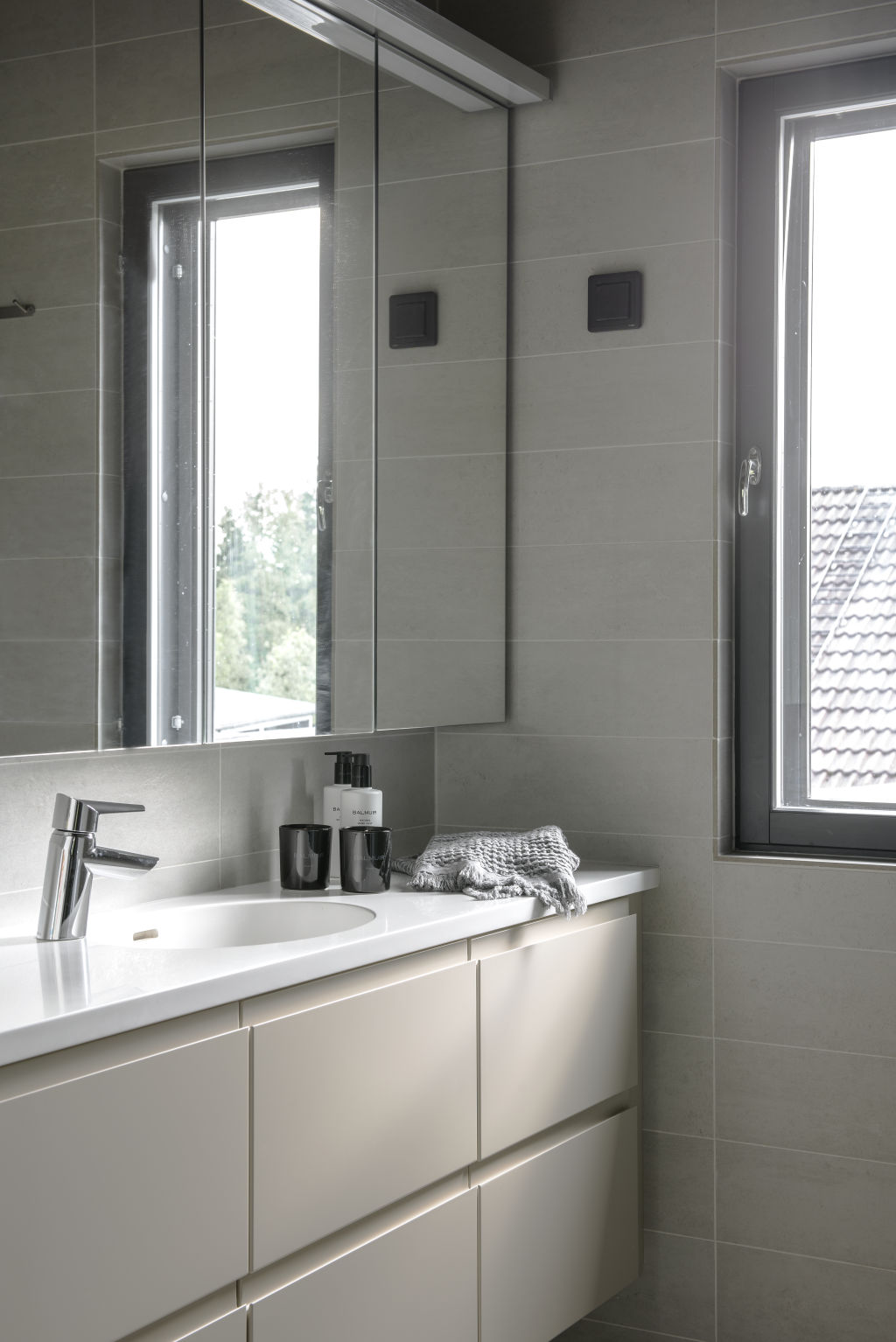 The upstairs bathroom is furnished with Kontio Living range of a white coffee shade.
